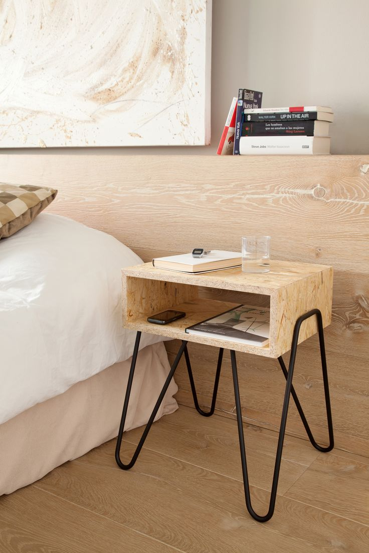 HANDY designed by Adolfo Abejón. Side table made with OSB and iron bar. This design is perfect as a bedside table for storing and easily accessing everyday items. The OSB drawer is supported by the iron structure which embraces it, creating two handles to move the table. Photo: Anna Alejo