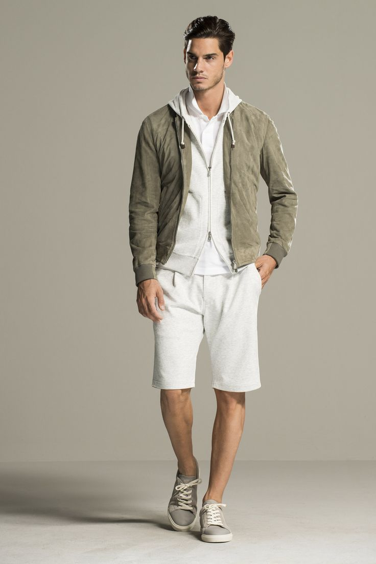 Pairing an olive suede bomber jacket with white shorts is a comfortable option for running errands in the city. Tap into some David Gandy dapperness and complete your look with grey plimsolls.   Shop this look on Lookastic: https://lookastic.com/men/looks/bomber-jacket-hoodie-polo-shorts-plimsolls/12047   — White Polo  — White Hoodie  — Olive Suede Bomber Jacket  — White Shorts  — Grey Plimsolls
