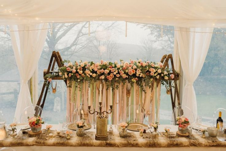 Beautiful flower arrangement behind the Bride and Grooms seats in the marquee