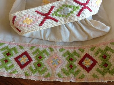 Vanha kirjailtu essu. Traditional Finnish embroidery in an apron.