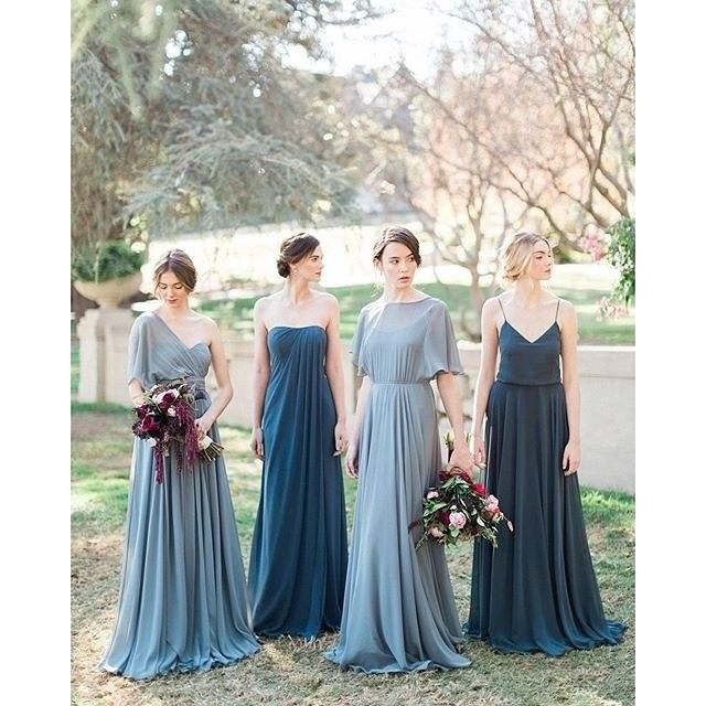 Stupendous combination of @jennyyoonyc's Storm and Denmark Blue dresses in chiffon from their new 2016 Collection. Captured by @carolinetran with florals by @hiddengardenflowers and HMU by @kcwitkamp. #jennyyoo #jennyyoo2016 #bridesmaids #2016wedding