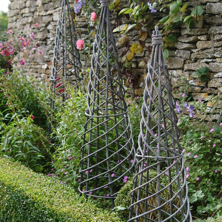 Vegetable supports,can you make this with tomato plant supports, turn upside down, attach wire in spiral, maybe spray paint it