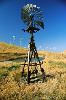 Old windmill with new windmills in background