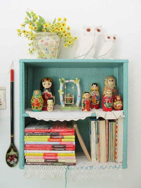 A cute collection of Babushka dolls brightens up a room ~ From Dottie Angel