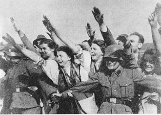 Sudeten German women welcome Adolf Hitler in 1938 following the Munich Agreement.