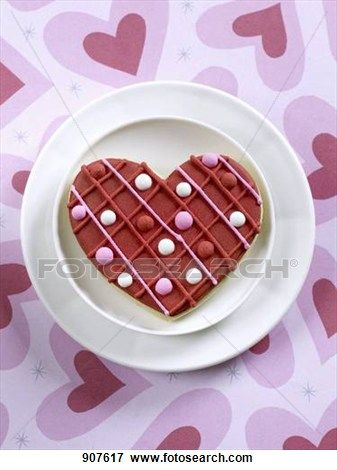 """A Heart Shaped Cookie for Valentine's Day"" - Valentine's Day stock photos available at Fotosearch.com"