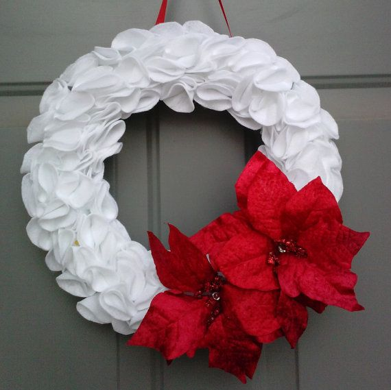 White felt wreath with red poinsettas. Etsy listing at https://www.etsy.com/listing/164607274/christmas-wreath-white-christmas-wreath