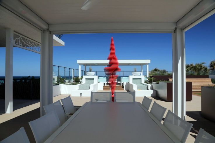 Ralfonso's latest kinetic sculpture is the red-hot Flamenco - here at a private home on the ocean in Florida.
