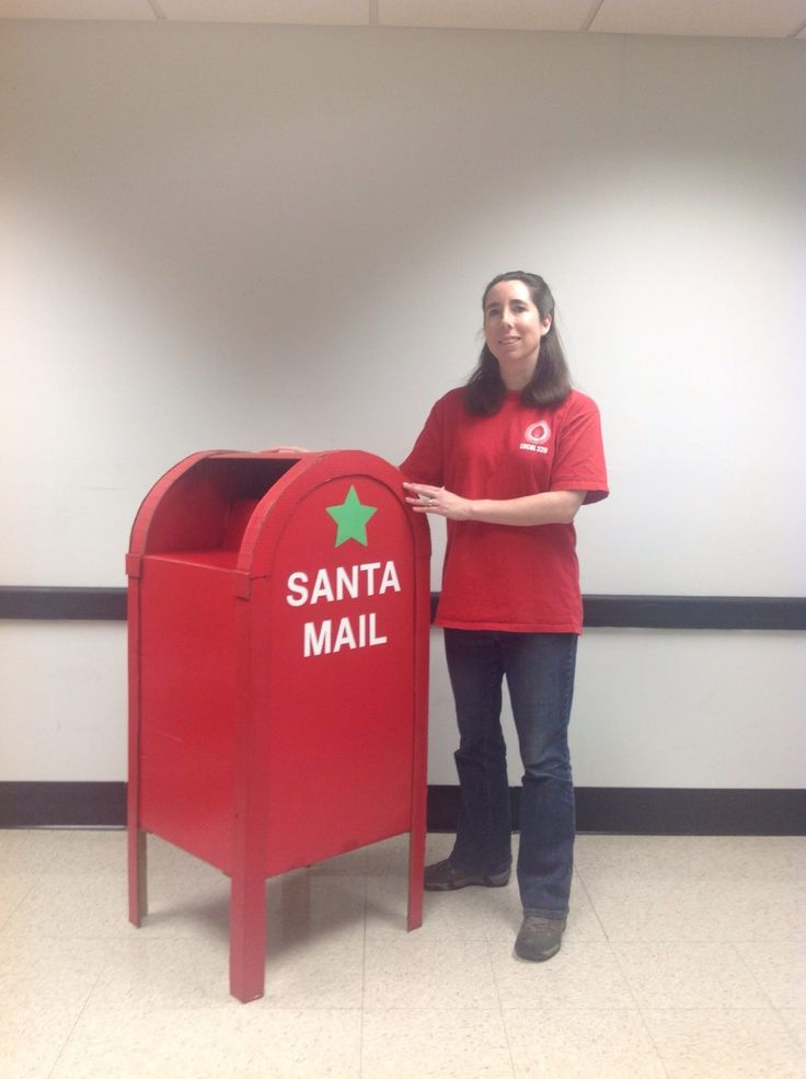 Mailbox for santa mail, made out of cardboard and using the same shapes and measurements of a USPS mailbox. I shortened the legs slightly to allow children to easily mail their santa letters. Made by T Cotter.