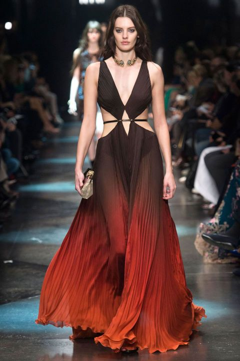 Roberto Cavalli - Fall 2015: And for wow factor, he ended with a series of beaded-to-the-hilt red and blue gowns and pants (that re-introduced the chinoiserie), but it was a trio of degrade plisse gowns with cut-outs at the waist that brought the drama.
