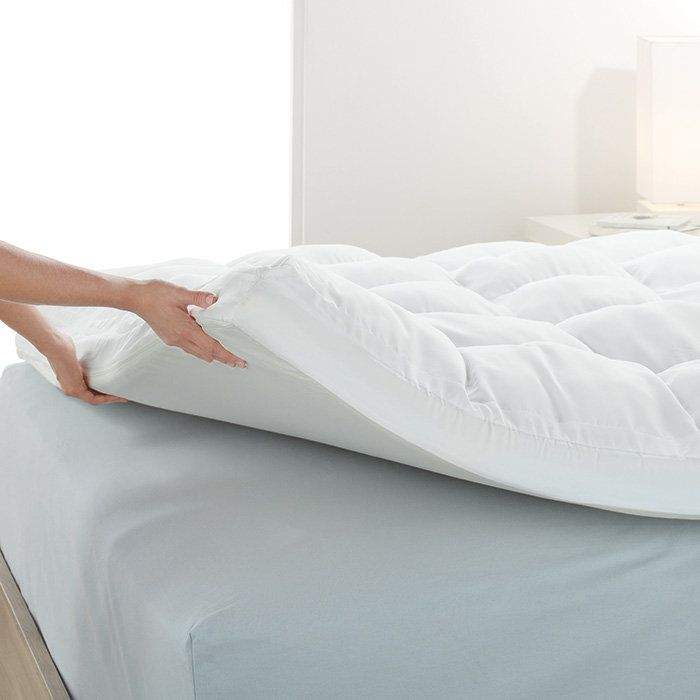sleep soundly on a biosense memory foam mattress topper from brookstone