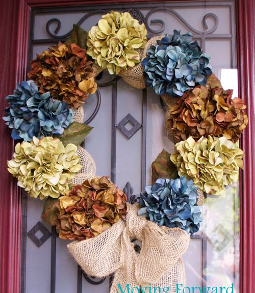 Blogger Margaret Pereira used a wire wreath form and faux hydrangeas to create a floral-themed accent for her front door. Get the tutorial at Moving Forward Redesign.   - CountryLiving.com