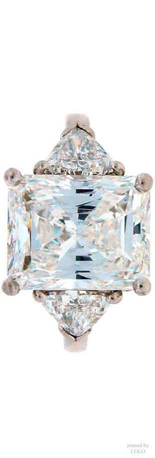 Cartier diamonds cut in a square princess with trilliants on the side