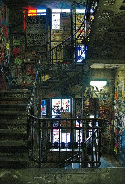 Gig posters, graffiti etc on walls of stairwell