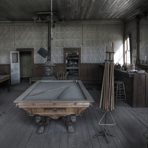 Abandoned saloon. Look at the cool feet on that pool table.