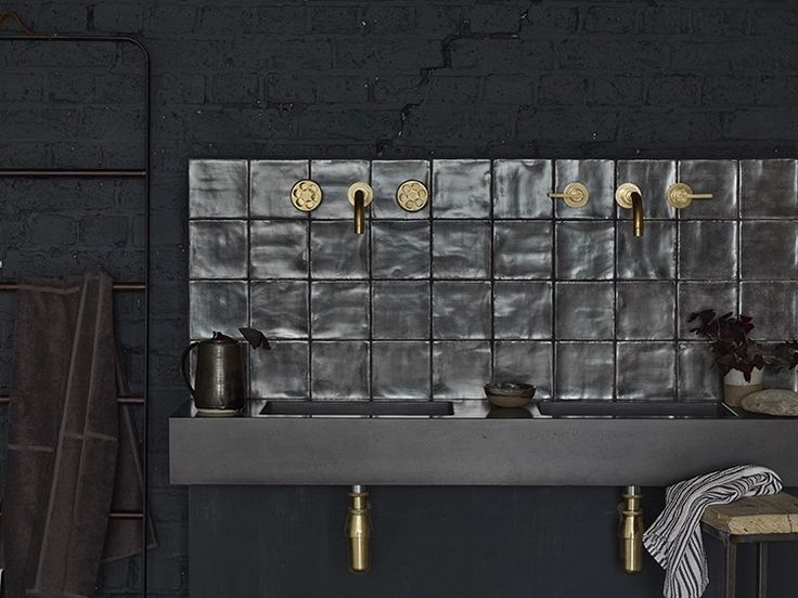 This exclusive bathroom range from Bert & May features brushed glazed tiles and a concrete basin