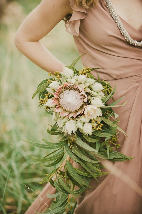 Stunning! Gum leaves and proteas #bouquet. Get inspired at diyweddingsmag.com #diywedding