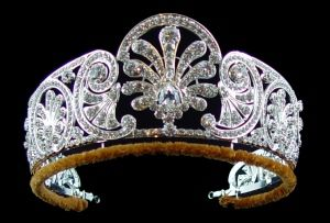 Queen Mary's diamond tiara is decorated with a graduated frieze of styled honeysuckle.    The central ornament is made to be detachable. It was made before or during Febuary 1914. HRH Princess Alice – Duchess of Gloucester was given the tiara by Queen Mary.