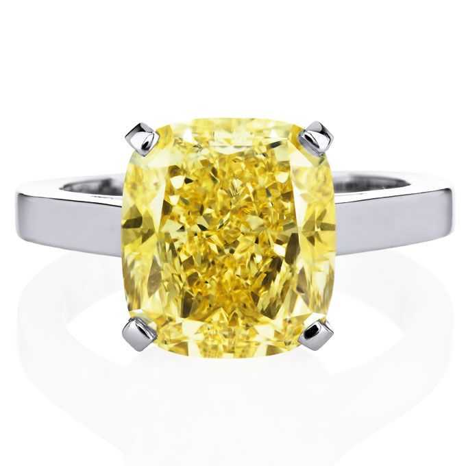 """Brides.com: Engagement Rings with Colored Stones. Style 9854, """"Classic"""" engagement ring with 10ct yellow cushion-cut diamond set in platinum, price upon request, De Beers  See more De Beers engagement rings."""