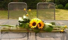 bloemstuk met polygonum en zonnebloemen gemaakt tijdens het dorpsfeest 2012