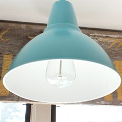 See how a $15 Ikea Foto pendant was transformed to look like a barn light with a little paint.