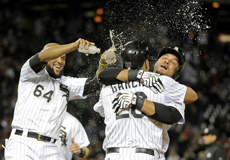 Celebration in Chicago -        Chicago White Sox right fielder Avisail Garcia (26) first baseman Jose Abreu (right) and second baseman Emilio Bonifacio (64) celebrate their win against the Detroit Tigers during the eleventh inning of a game on June 5 at U.S Cellular Field in Chicago. The White Sox won 4-3.  -  © David Banks/USA TODAY Sports