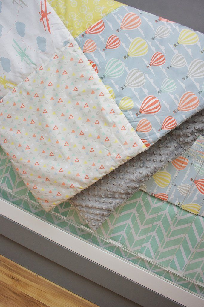 The perfect gender neutral baby bedding for your adventure nursery decor! We are loving the hot air balloon crib sheet and soft colors of mint, blue, yellow and tangerine. *SET INCLUDES CRIB SHEET AND