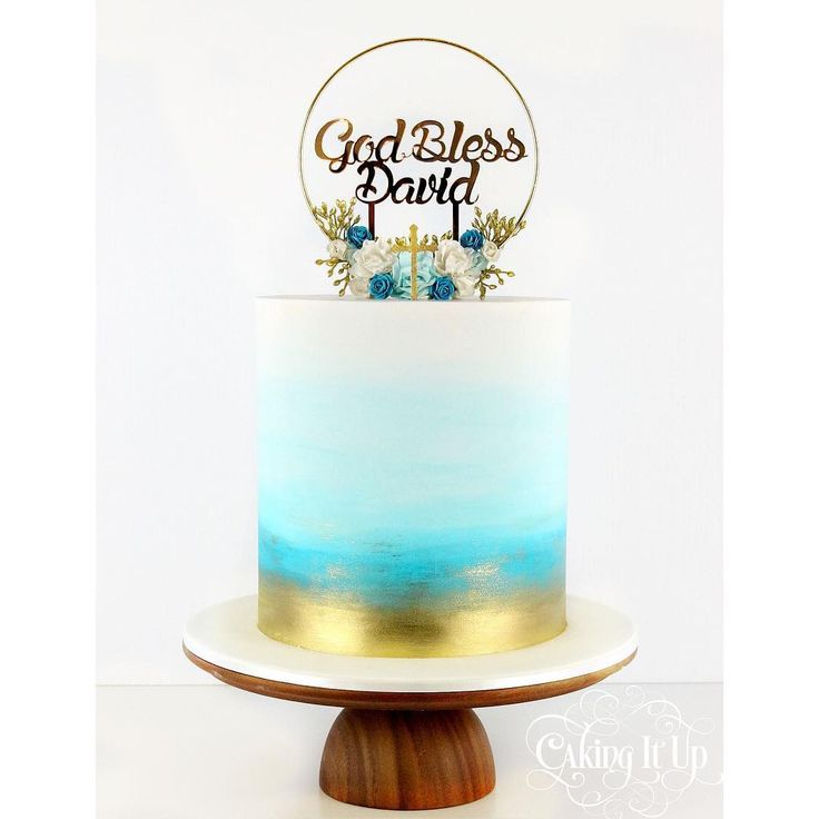One tier gold and blue watercolour wash christening cake with handmade wreath and gold mirrored topper supplied by client. #cakingitup #religiouscakes #blue #ombre #gold #fondant #onetiercake #wreath #cakedecorating #cakedesign #sydneycakes #instacakes