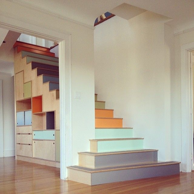 Stairs! With a rainbow of color laminate. Plus, storage cabinets, drawers, and sliding doors underneath. Maple plywood. By Kerf Design kerfdesign.com