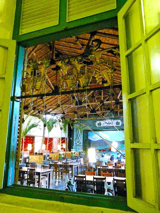The interior of Restaurant Inggil strongly gives a Javanese ambience by adding the decorations with Wayang Pupet and The...