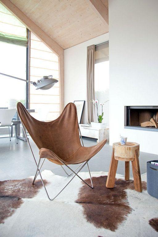 Vlinderstoel met leren bekleding, blijft een must-have, ook al is het ontwerp meer dan zeventig jaar oud.