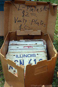 Displaying car license plates for sale at a yard sale. photo by Lynnette at TheFunTimesGuide.com