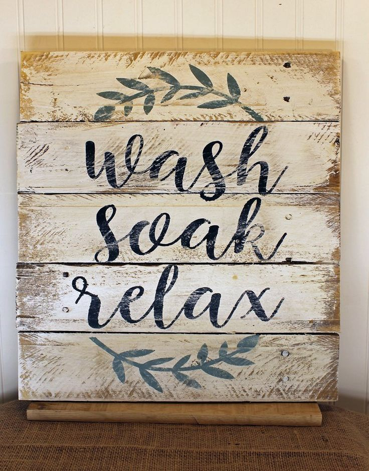 White Bathroom Relax Unwind Quote Reclaimed Wood Pallet Sign 16x17. A nice hot soak in the tub is one of life's greatest luxuries. This shabby chic design is perfect for decorating a rustic bathroom and a gentle reminder of the miracles that happen in a tub of hot water. Wash. Soak. Relax. OR Relax. Soak. Unwind. 16x17 Due to the handmade nature of each sign, there may be slight variations.