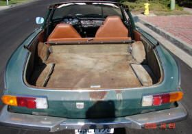 Volvo convertible-made (?) P1800: much room in the back, but Lord, don't let it rain!