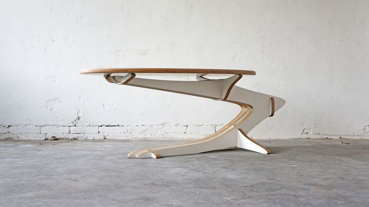 With its curved shape Qvist Coffee Table appears dynamic and lively, while the overall composition expresses calm and simplicity. The table consists of 8 sub-elements made of laminated birch veneer individually oiled and waxed. Dimensions: H. 52 cm. W. 70 cm. L. 151 cm. (oval plate: W. 61 cm L. 122 cm) Basic model is white, but available in other colors on request.