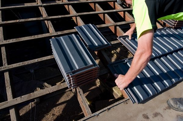 Re-Roofing: Laying the tiles ontop of each other – cross bonded.