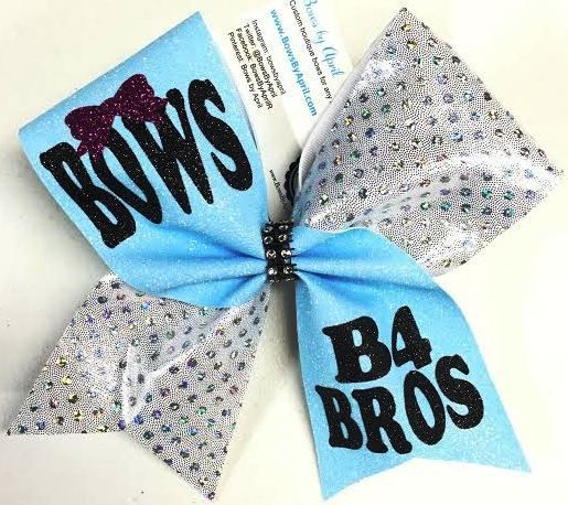 Bows by April - Bows B4 BROS Blue Glitter and White Holographic Dot Cheer Bow, $17.00 (http://www.bowsbyapril.com/bows-b4-bros-blue-glitter-and-white-holographic-dot-cheer-bow/)
