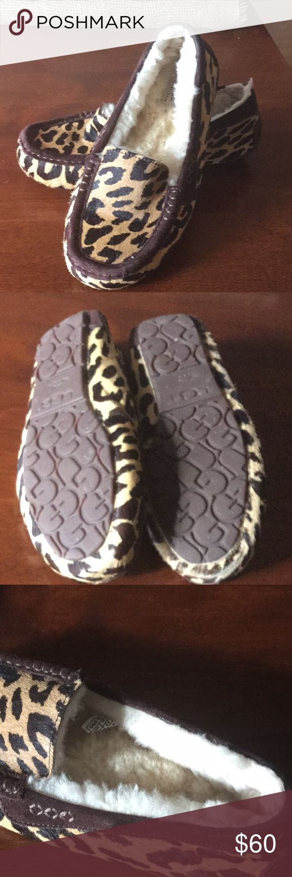 Ugg animal print slippers Ugg slippers.  Animal print with sheepskin lining. Perfect condition. Only worn a few times. Size 9 women's UGG Shoes Slippers