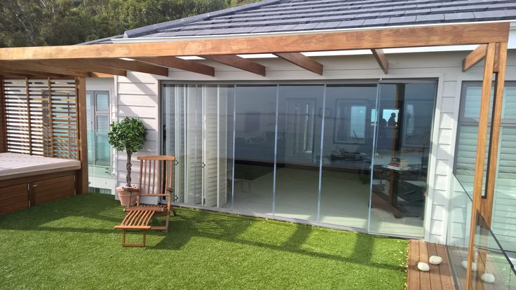 Frameless glass stacking unit installed in Camps Bay
