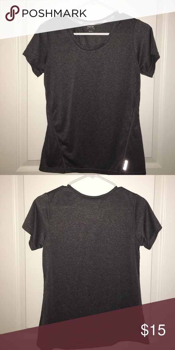 Reebok Dri-Fit workout top Washed and hung up but never worn ladies workout top by Reebok. Reebok Tops Tees - Short Sleeve