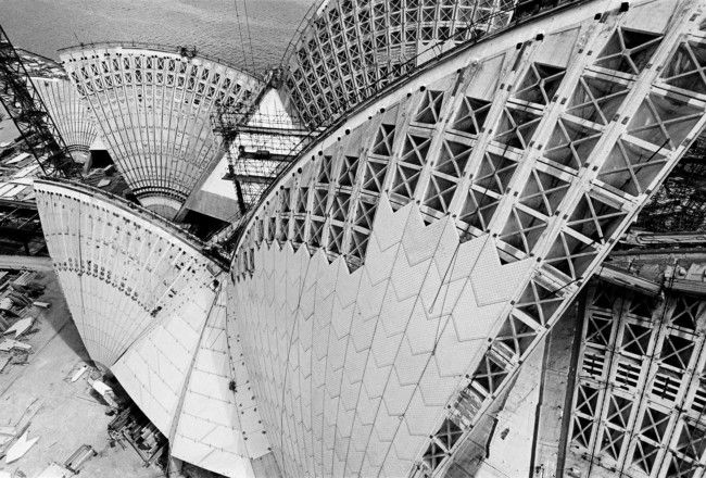 Striking photographs by David Moore document the construction of the Opera House