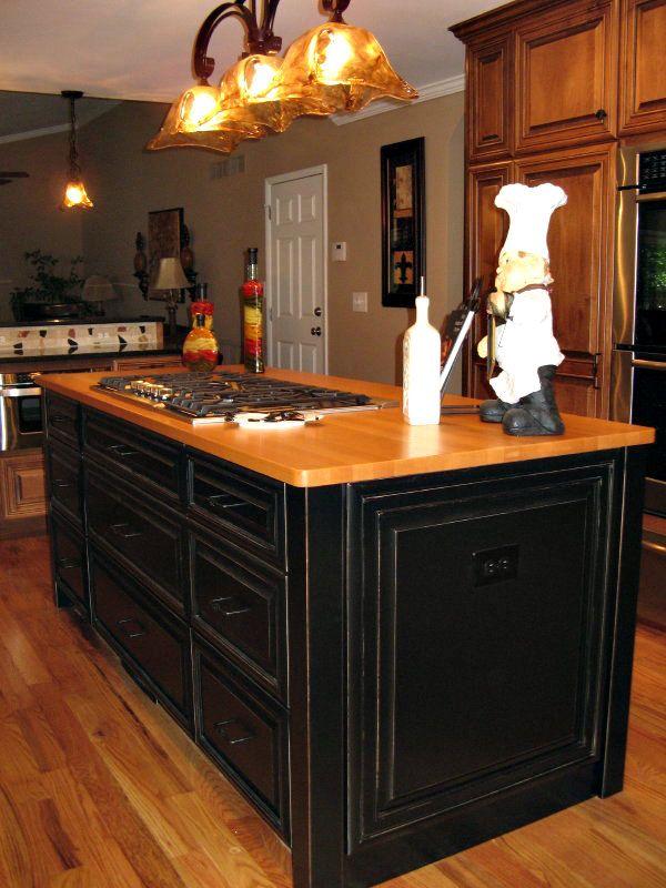 Large Black Painted Kitchen Remodel Island with cooktop and butcherblock countertop.  Pogue Cabinets Atlanta, GA 770-975-9350