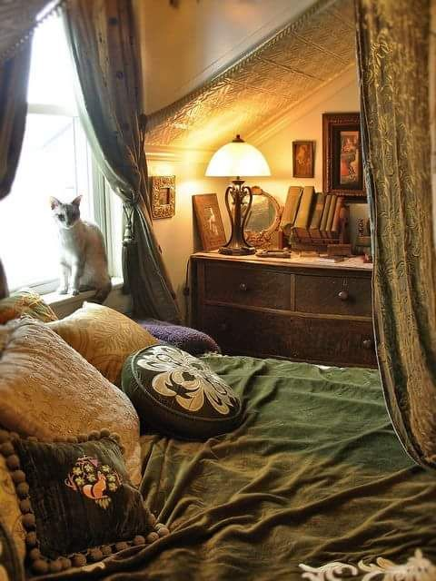 A Cosy Bedroom under the Eaves, with Embroidered Cushions, Old Books & Pictures, an Art Nouveau Lamp and .... a Cat on the Windowsill ....