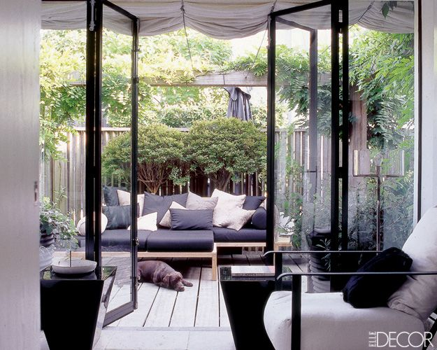 Marcel Wolterinck's home in an Amsterdam --- secluded garden with a wisteria covered pergola --- photo by  Vincent Thibert --- Elle Decor