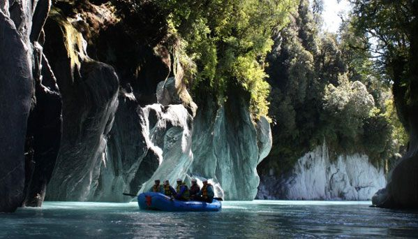 The Whataroa River at its best, deep flowing waters passing stunning limestone cliff faces.