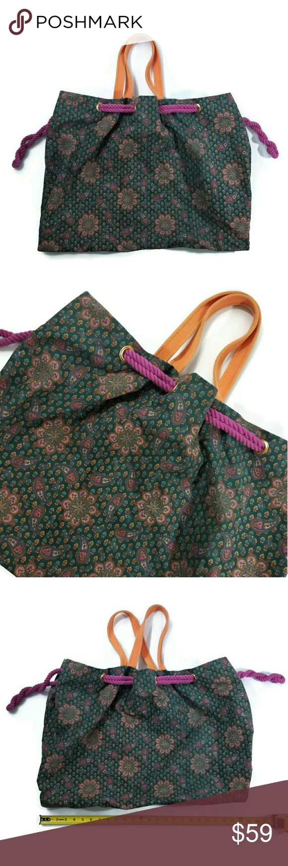 """Marc Jacobs large paisley tote bag Good condition. Paisley print on the fabric with orange straps. A thick purple rope is used as a draw string to pull the bag closed. Almost converts the bag from a large Tote to a large Hobo bag. The inside tag says """"Jacobs by Mark Jacobs for MARC by MARC JACOBS"""". The liner is black and has a zippered pocket. Approximate measurements 23""""x19"""". Marc By Marc Jacobs Bags"""