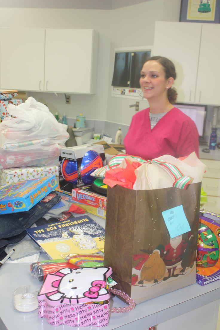 Tiffanie surrounded by toys #Animal Hospital #Veterinarian #Pets #Vet #KAH #FrederickMaryland #Christmas #GivingBack