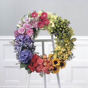 Small Arrangements: in oranges, yellows, and reds...roses, stargazers, tuips, hydrangea Around wine chillers