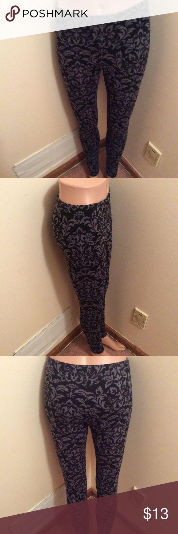 Floral leggings/Tights Black & greyish blue floral tights/leggings - fleece material - very soft & warm - new, never worn Pants Leggings