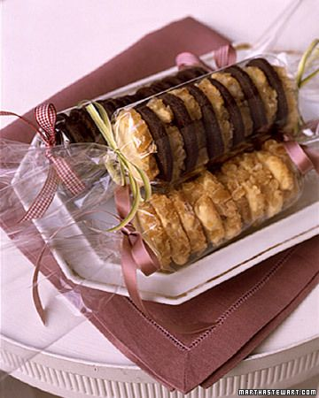 Martha Stewart tips on packaging cookies: Labors of love as pretty as home-baked cookies needn't be hidden by paper or cardboard. Here, neat rows of chocolate-espresso wafers and orange-ginger rounds are rolled in cellophane, and the ends are finished with ribbons.